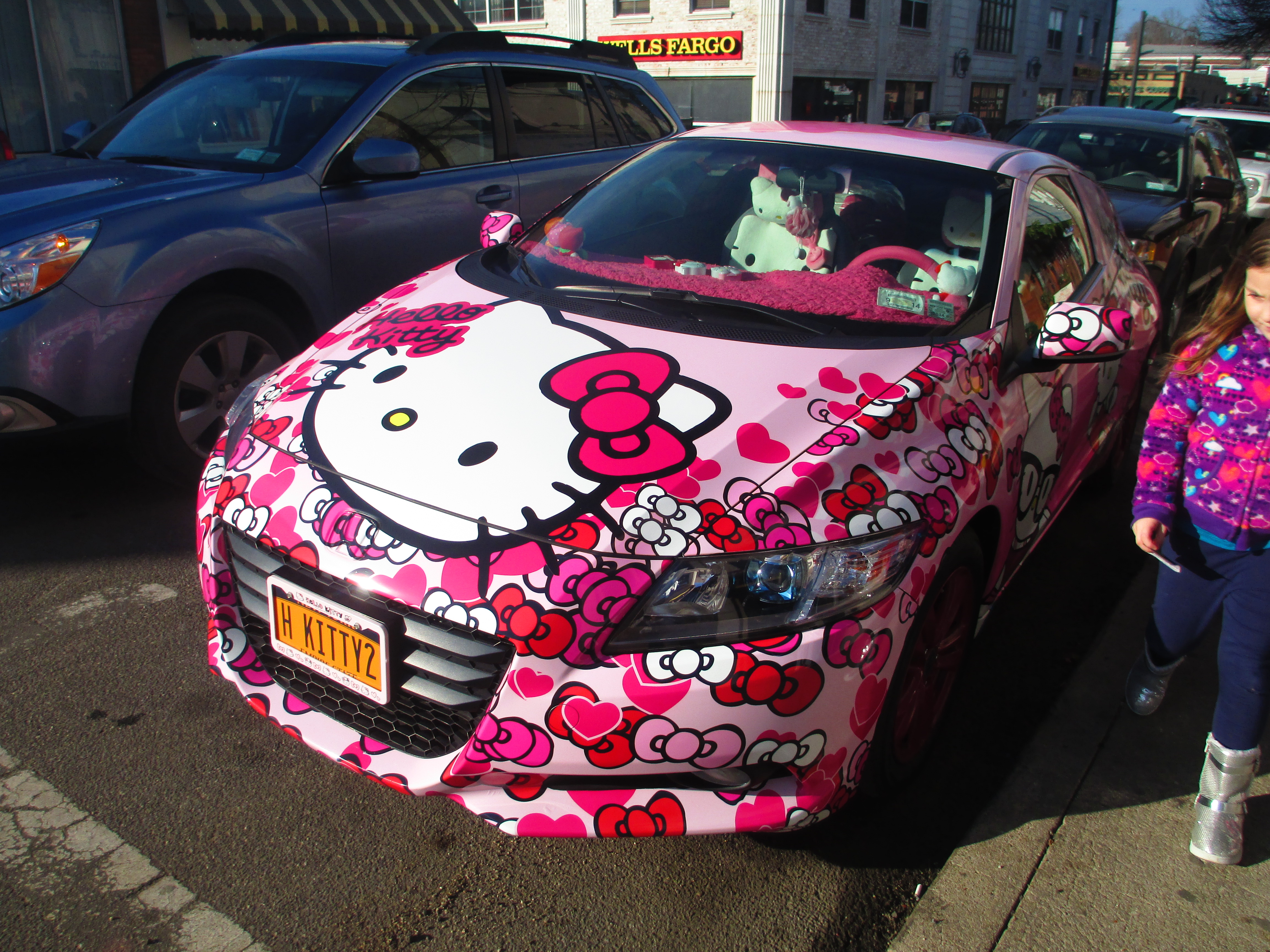 we were walking through the village and saw this car my kids immediately swooned hello kitty everything even on the inside